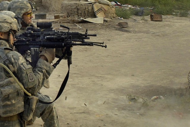 Soldiers from Troop B, 5th Squadron, 73rd Calvary Regiment, 82nd Airborne Division, exchange gunfire with insurgents in Al Haymer, July 12.