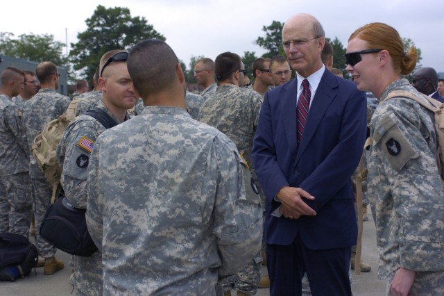 Secretary of the Army Pete Geren talks with Minnesota National Guard Soldiers deployed with the 1st Brigade Combat Team, 34th Infantry Division to Iraq for the past 17 months during their redeployment at Volk Field, Wis., July 17.