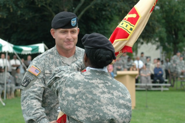 Col. Robert Ulses returns the U.S. Army Garrison Heidelberg colors to Command Sgt. Major Yolanda Lomax during the unit's change-of-command ceremony today.