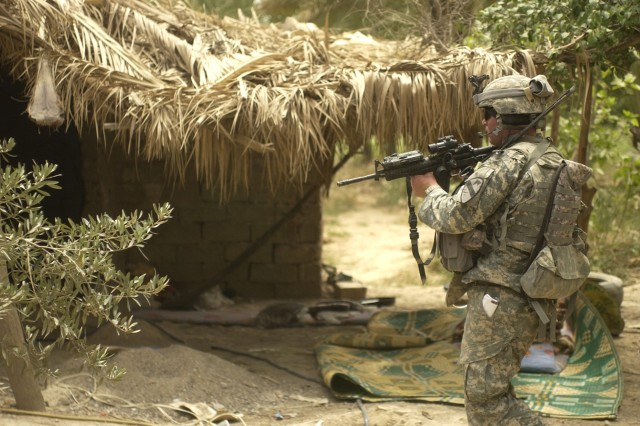 A Soldier from the 1st Cavalry Division clears an al Qaeda prison camp south of Baqubah, Iraq.