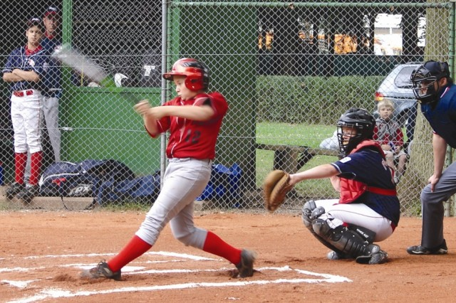 Joe Patrick of the Stuttgart/Wiesbaden Bulldogs takes a big swing during the team's run at the Little League German District title. Next up, the Bulldogs travel to Poland to compete against the top European teams of Little League baseball.