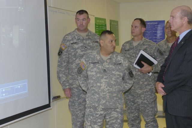 Secretary of the Army Pete Geren views the system used to train Soldiers the basics in the Arabic language at Fort Riley, Kan., July 20.
