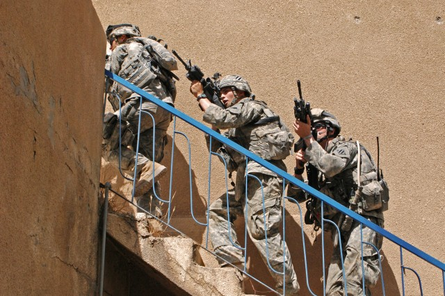 Soldiers from 1st Battalion, 30th Infantry Regiment, 2nd Brigade Combat Team, 3rd Infantry Division clear a house in Baghdad, June 26.