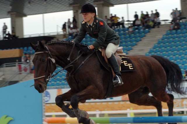 U.S. Army World Class Athlete 1st Lt. Mickey Kelly of Fort Carson, Colo., rides Tai Pan in the equestrian riding portion of the women's modern pentathlon July 23 at XV Pan American Games Rio 2007 in Rio de Janeiro, Brazil. First Lt. Kelly won the bronze medal and secured a berth in the 2008 Olympic Games in Beijing, China.