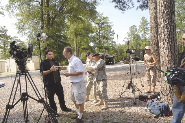 """The production crew of the Food Network show """"The Secret Life Of..."""" and Fort Lee Soldiers take a break in shooting for a segment that will focus on military feeding systems. The taping took place July 12 at the Field Operations Training Branch of the Army Center of Excellence, Subsistence at Fort Lee, Va."""