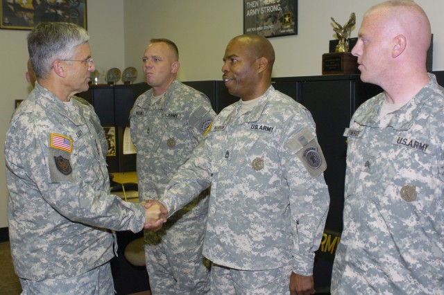 Army Chief of Staff Gen. George W. Casey congratulates a Mechanisburg, Pa., Recruiting Station recruiter, who helped the station reach its yearly recruiting goal six months into the recruiting year at Mechanicsburg, Pa., July 27.