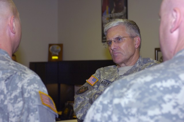 Army Chief of Staff Gen. George W. Casey listens as a Mechanisburg, Pa., Recruiting Station recruiter offers his suggestions for the Army's recruiting strategy July 27.