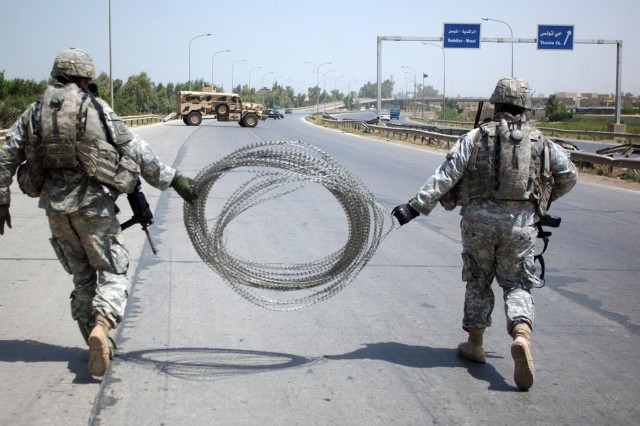 Soldiers set up security at their traffic control point.
