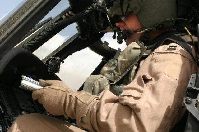 Maj. Robert Kneeland goes over his flight plan.