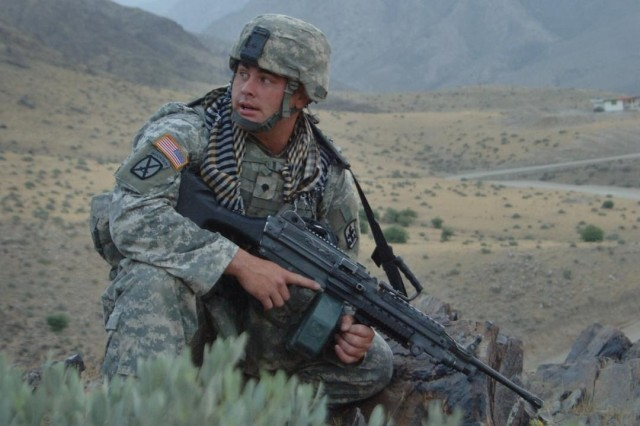 Spc. Chris Hurst pulls security for fellow Soldiers.