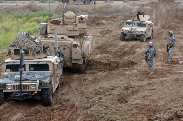 A convoy advances down the new road.