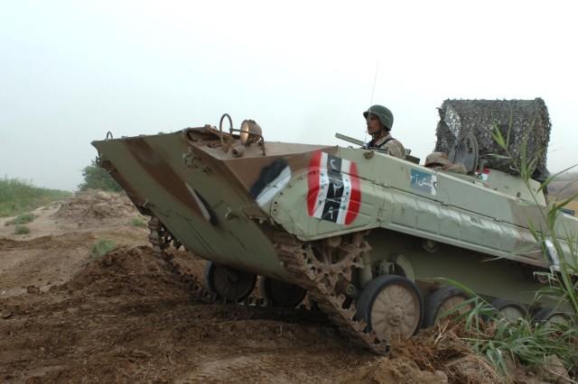 An Iraqi BMP traverses the new road.
