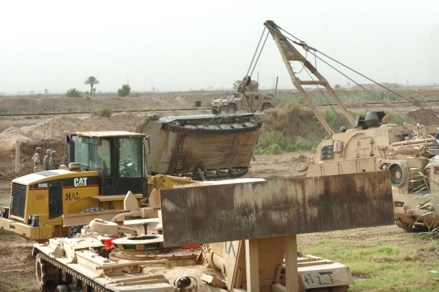 Sappers flip an Iraqi BMP back on its tracks after it rolled over.