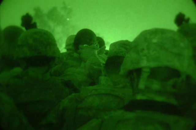 Sappers pray before going on another night mission.