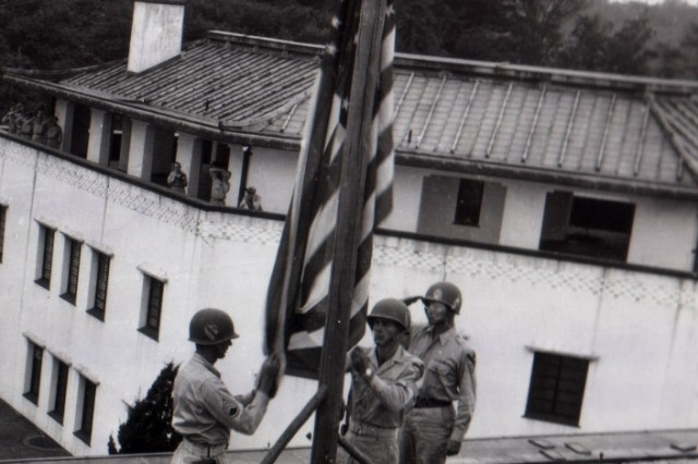 The same flag that flew over the White House at the time of the Japanese attack on Pearl Harbor is raised over the American Embassy in Tokyo by Soldiers of the 9th Cavalry Division suring a ceremony marking the official U.S. occupation of Tokyo. (September 9, 1945)
