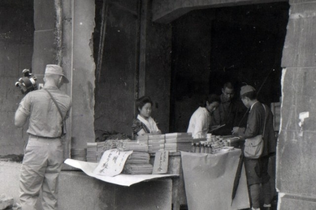Japanese store in a burned out building in the Tokyo shopping district, where Japanese civilians make use of available space to carry on their business. (September 2, 1945)