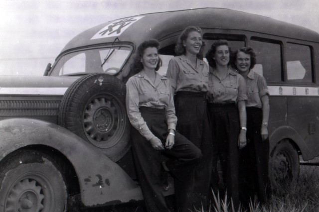 Standing next to an abandoned Japanese ambulance, these three Army nurses served in the first American hospital established in the Tokyo area after the war.  Seen (left to right) are Second Lieutenants Norma Gabs, Klayta Chaplin, Jennabelle Harding and Doris Turner. (September 2, 1945)