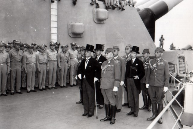 The delegation representing the Emperor of Japan and the Japanese Imperial government arrive aboard the U.S.S. Missouri in Tokyo Bay to participate in surrender ceremony. (September 2, 1945)