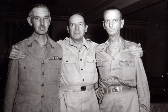 Gen. Douglas MacArthur is seen at his headquarters in the New Grand Hotel, Yokohama, Japan, shortly after the arrival of Lt. Gen. Jonathan Wainwright (right) and Lt. Gen. A.E. Percival (left), British Commander at Singapore. (August 31, 1945)