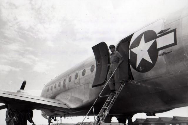 General Douglas MacArthur leaves his plane to step onto Japanese soil at Atsugi Airport, Japan. (8/28/45)