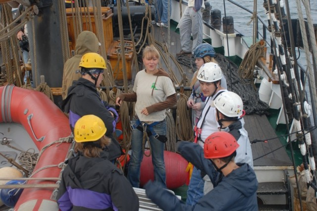 A German member of the schooner crew reviews ship procedures with Camp A.R.M.Y Challenge participants.