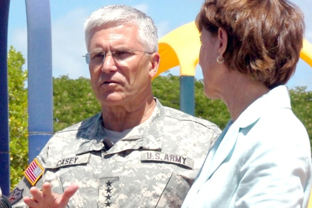 Army Chief of Staff Gen. George W. Casey Jr. and his wife, Sheila, discuss Army Family initiatives during a visit at the Fort Shafter, Hawaii, Child Development Center Aug. 3.