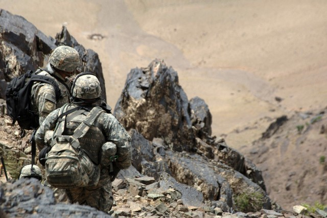 Soldiers peer into the valley, looking for suspicious activity as they enjoy the view.