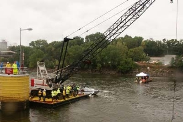 The Corps' 100-ton crane barge is helping with search and recovery.