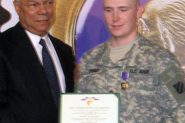 Retired Gen. Colin Powell, presenting Purple Heart Medals to wounded Soldiers at Walter Reed July 7.