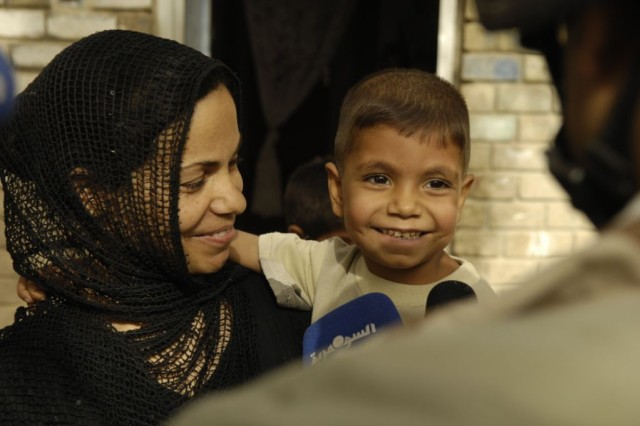 Ahaip Najim and his mother greet Arabic media representatives at their home in Hollandia June 2 before the boy's trip to al Sadr Hospital in Najaf for a life-changing surgery. Soldiers from the 3rd Heavy Brigade Combat Team, 1st Cavalry Regiment, worked with Iraq's Ministry of Health to coordinate the surgery and provided transportation on U.S. Army helicopters to Najaf.