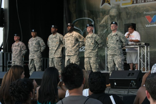 Six Soldiers receive on stage recognition at Chicago's Soldier Field during Boost Mobile's Night Shift, a car show featuring import cars, DJ music and entertainment.