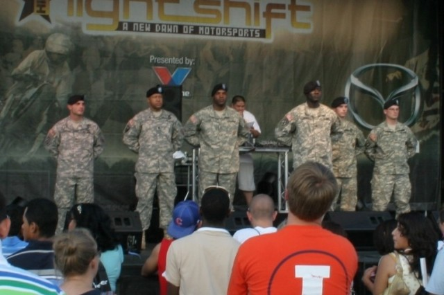 Six Soldiers receive on-stage recognition at Boost Mobile's Auto Show at Chicago's Soldier Field.