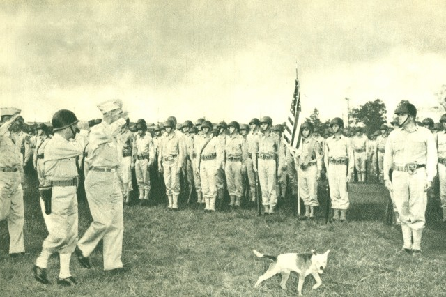 """Maj. Gen. William C. Lee, commander 101st Airborne Division, reviews his men at Camp Claiborne, La., during activation day ceremonies. Source: """"The Epic of the 101st Airborne: A Pictorial Biography of the United States 101st Airborne Division compiled and arranged by the unit Public Relations Office, 1945."""""""