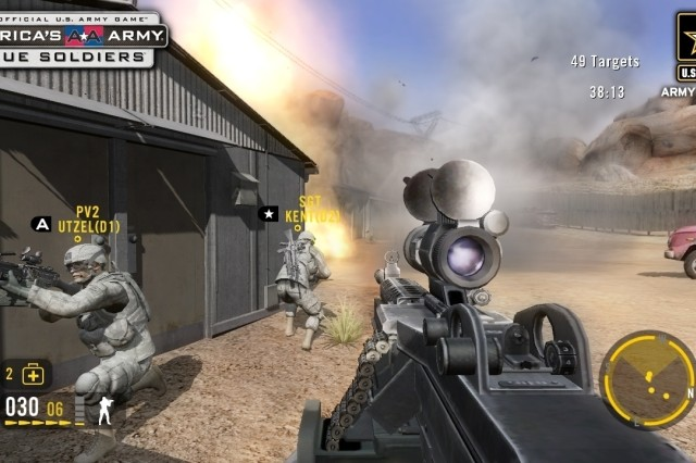 "Soldiers in ""America's Army: True Soldiers"" attack an enemy encampment in the fictional country of Ganzia. The player controls the weapon in the foreground. Before using a weapon in combat, players must meet Army training standards."