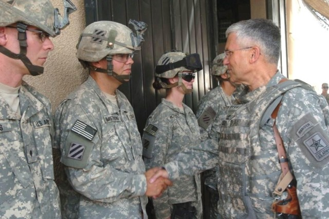 Army Chief of Staff Gen. George W. Casey Jr. speaks to Soldiers from the 3rd Heavy Brigade Combat Team Aug. 11, at Patrol Base Assassin, Iraq.