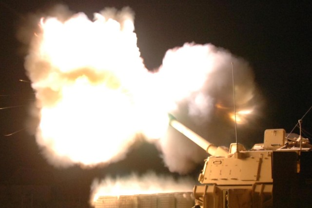 """Firing teams """"Gunny"""" and """"Storm"""" from the 2nd Battalion, 82nd Field Artillery Regiment, 3rd Brigade Combat Team, 1st Cavalry Division fire a M109A6 Paladin self-propelled howitzer at insurgents Iraq's Diyala River Valley in support of Operation Lightning Hammer, which was just underway when the rounds were launched late into the night, Aug. 13."""