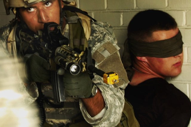 Soldiers rescue a role-playing hostage.