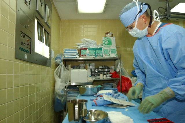 Army Sgt. Julian Munoz, a surgical specialist from Fort Sam Houston, prepares instruments for a surgery Aug. 14 at Hospital Escuela in Tegucigalpa, Honduras.  Sergeant Munoz is visiting Honduras as part of a hand-surgery Medical Readiness Exercise, commonly called a MEDRETE, Aug. 13-24.  Medical personnel from military installations across the United States joined with personnel from Soto Cano Air Base in Honduras to conduct the MEDRETE.  The MEDRETE team anticipates treating nearly 100 patients by the end of the exercise.