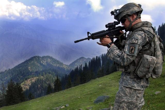 1st Lt. Chris Richelderfer looks for possible enemy positions.