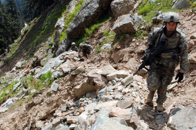 Capt. Nathan Springer leads Soldiers through the rugged mountains, following a goat trail.
