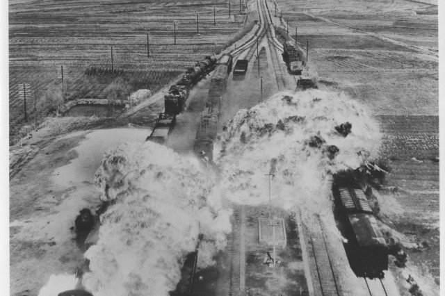 While the military kept America's railroads running under Truman, it sought the opposite elsewhere.  Here, the Fifth Air Force's 452nd Light Bomb Wing drops napalm on rail cars south of Wonsan, North Korea, an east coast port city, circa