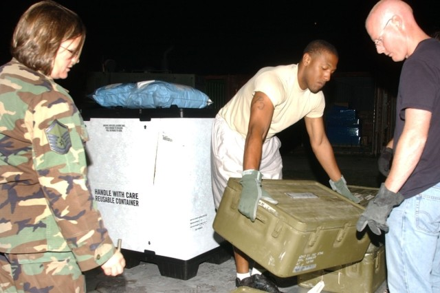 From left, Air Force Master. Sgt. Deborah Davis, Army Sgt. Patrick Dickens and Master Sgt. Dan Cockrell, pack supplies at Soto Cano Air Base, Honduras, Aug. 16 for the Mobile Surgical Team's deployment to Peru to assist with earthquake relief