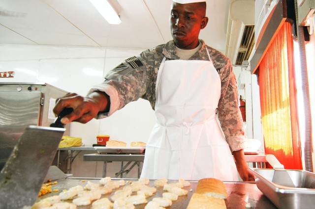 Sgt. 1st Class Ed Stewart, cook and NCO in charge of Food Service for 3rd Heavy Brigade Combat Team, 3rd Infantry Division, prepares shrimp for the shrimp po' boy sandwich during the Iron Chef Competition Aug. 16 at Forward Operating Base Hammer, Iraq.
