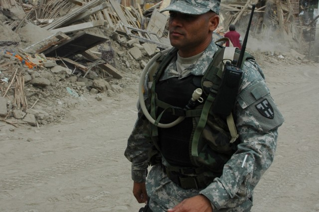 Pfc. David Torres, a Joint Task Force Bravo member, participates in the medical humanitarian relief mission in Pisco, Peru.