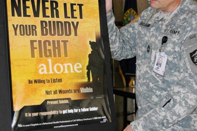 Master Sgt. Marshall Bradshaw, the Army National Guard's Suicide Prevention Program manager, posts a suicide prevention placard at the National Guard's joint headquarters at Jefferson Plaza One in Arlington, Va., Aug. 17. Statistics reveal suicide is the third-leading cause of death among National Guard Soldiers.