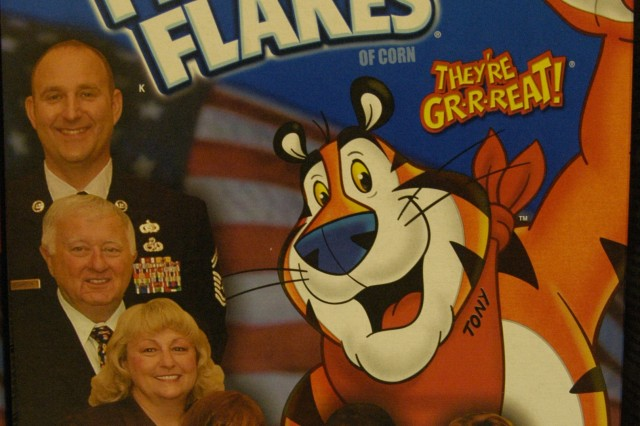 Robin Crouse's picture (fourth from left) is featured on boxes of Kellogg's Frosted Flakes as recognition for receiving the National Military Family Association Very Important Patriot award. Mrs. Crouse is the executive director for the United Services Organization at Fort Hood, Texas.