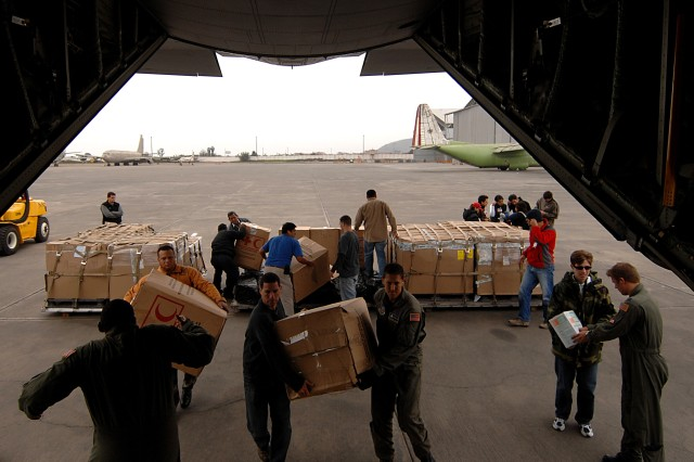 Soldiers and Airmen offload supplies in Lima, the capital city.