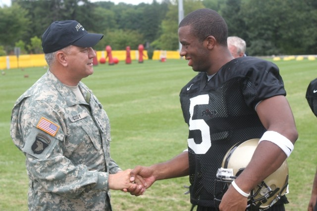 August 18, 2007.  Gen. Richard A. Cody, U.S. Army Vice Chief of Staff, shaking hands with U.S. Military Academy (USMA) Cadet and football player, Jeremy Trimble.