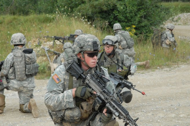 In a field rotation at Grafenwoehr Training Area, the Soldiers of 2BCT 1AD practiced covering each other while dismounting from their vehicles, and then moving on to clear the area.