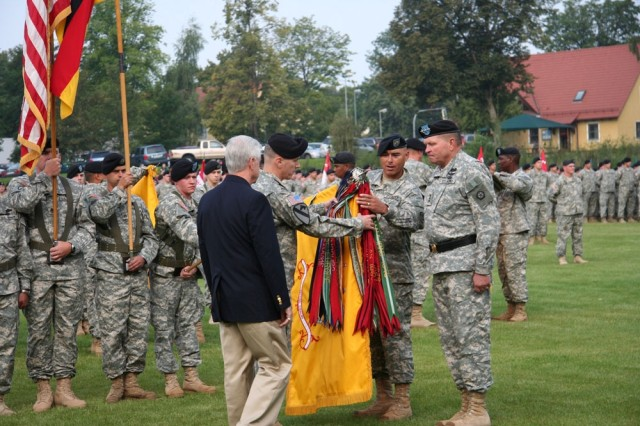 Col. John RisCassi, commander of the 2nd Stryker Cavalry Regiment; 2nd SCR Command Sgt. Maj. Victor Martinez; Chris Golden, a senior representative of the 2nd SCR Association, and former V Corps Commander Lt. Gen. James E. Thurman prepare to case the regiment's colors during a farewell ceremony in Vilseck Aug. 3. The ceremony marked the regiment's deployment in support of Operation Iraqi Freedom.